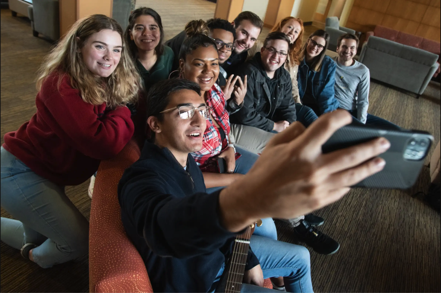 valpo students taking a photo together in a residence hall