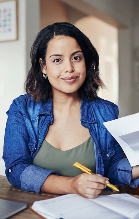 Confident, young looking woman studying.