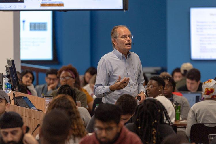 Professor giving lecture in auditorium